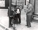 (01 08 001) Rawlins Cross, St. John's. Young boys selling newspapers at the intersection pre 1950
