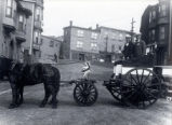 01.10.002: Transport, St. John's. View looking up Bates Hill with horse and cart in the foreground...