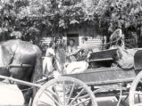 (01 10 003) Transport, St. John's. Horse and cart in front of house with three women and one man,...
