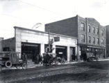 (01 10 006) Transport, St. John's. Cars parked outside Ford Sales & Service and Royal Bank of...