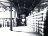 (02 01 023) Mercantile and Manufacturing, St. John's. Interior view of premises showing stacks of barrels,