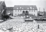 (03 02 003) Waterfront, St. John's. Tessier's warehouse, with salt cod drying on the wharf, pre-1892