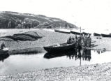 07.02.001: Torbay and area. Men hauling up boats, Torbay, looking north, probably pre-1930