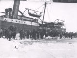 25.01.001: Seals. Sealers standing on the ice near a ship, post-1905
