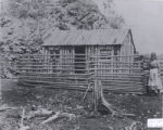 "(32 02 001) Pilley's Island. ""Log house - probably miners' tilts at Pilley's Island,"" Notre Dame Bay,"