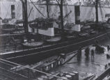 (32 07 008) St. John's. A ship at port, with a group of men on the dock, the Narrows