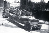 (05 03 006) World War I, St. John's. Peace parade, Job Street, with a banner saying Jensen Camp, 5...