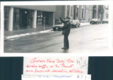 "Constable Frank ""Dusty"" Miller directs traffic at the Prescott and Duckworth..."