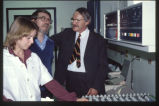23 (L-R) unidentified female, Mr. Mike Newton (technologist) and Dr. Richard (Dick) Huntsman...