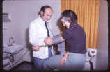 12 (L-R) Dr. Ken Saltman (Family Practice) and Ms. Gladys Chaulker (fake patient)
