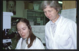 64 (L-R) Unidentified female and Dr. Penny Allderdice, geneticist