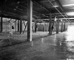 094 Level 1 - shared facilities - animal care area showing concrete floor slab and drainage piping...