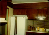 View of the kitchen of a home in Stephenville showing refrigerator