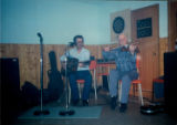 Émile Benoit and Howard Oliver play the fiddle and the guitar at the talent show at 'Club Vue de...