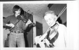 Émile Benoit and Kelly Russell playing the fiddle