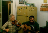 Émile and Jerry-Albert Benoit provide music for the folklore students' last party during their...