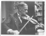 Émile Benoit playing the fiddle