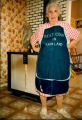 Anastasia Lainey, Mainland resident, modeling an apron in her kitchen