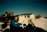 Rose Marie Tapp, folklore student, on snowmobile, enjoying a favourite local pastime in Mainland