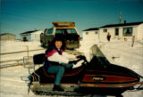 Sheena Power, folklore student, on a snowmobile enjoying a favourite local pastime in Mainland