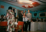 Dr. Gerald Thomas receiving an award at the Remembrance Day dinner at the French Centre in Black...