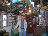 Charlie Pearcey (at time of interview) standing among his family's artifacts in the twine shop