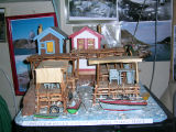 Charlie Pearcey's Twine Store - Bob Pearcey's wood carving of Pearcey's and Wells' stages and twine