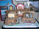 Charlie Pearcey's Twine Store - Bob Pearcey's wood carving of Pearcey's and Well's stages and twine