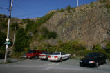 Fort Waldegrave Road - Cars parked near a giant rock wall