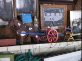 Charlie Pearcey's Twine Store, horse drawn carriage carving