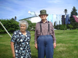 Tom Sullivan and his wife Ida in their side yard, Calvert
