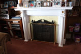 Collins, Randy. The fireplace in Collins' home on Cable Avenue.