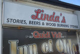 Hennebury, Linda. Inn of Olde sign in Quidi Vidi.