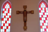 Decorative cross  and stained glass inside St. Patrick's Parish.