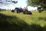 Photo of Michael O'Brien mowing