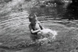 Alyward, Sandy. Boy in a pond.