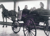 Kane, Linda. Image 14b – Horse and cart display in showroom. LtoR Anna Reid, Marilyn Ford, and...