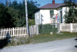 Pearl Squires, Edna and Jake Tucker standing on deck of house.