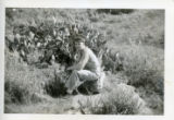 Charles H. Olaski in uniform sitting in front of cacti.