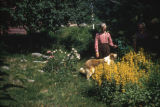 Pearl Squires, Jake Tucker, and Butch the dog in garden.