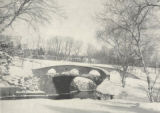 Snow, Peggy. Photo of Bowring Park's pink granite stone bridge in winter.
