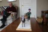 Warren, Phil. Phil Warren and his sculpture of a goat and horncat done by Esau George.