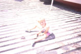 Child sitting on wharf