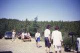 Group of people at wooden whale sculpture site