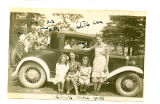 Cantwell, Theresa Squires. Black and white photograph of ten people in, on, and in front of a car...