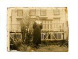 Cantwell, Theresa Squires. Black and white photograph of woman in front of fence from Theresa...