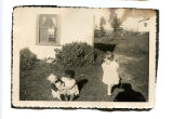 Cantwell, Theresa Squires. Black and white photograph of three children in front of house from...