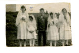Cantwell, Theresa Squires. Black and white photograph of four girls and a boy in confirmation...