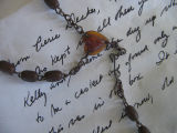 Buried treasure, letter and rosary, close up view, Joe Batt's Arm