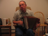 Joe Emberley with his accordion, Joe Batt's Arm